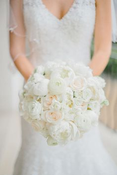 Peony, rose and ranunculus wedding bouquet: http://www.stylemepretty.com/2017/04/28/glamorous-seaside-wedding-in-barbados/ Photography: Jacob and Pauline - http://www.jacobandpauline.com/