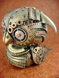 the entire thing is handsculpted from polymer clay and finished with mica powders for an awesome metallic effect. Want to see all the MechOwlies I have made so far? http://monsterkookies.deviantart.com/gallery/?q=mechanical+owl