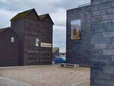 Old and new on the Fishermens Stade in Hastings, East Sussex. Black timber clad net shops and the Jerwood Gallery clad in black ceramic tiles
