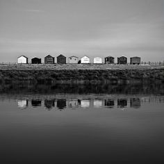 Beach huts by the water.