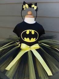 Slap the bat symbol on the front of a black or yellow swim suit and VIOLA! Batman-girl!  Batman female costume