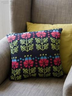 buyable knitting pattern for a knitted cushion with Art Nouveau stylized flower from Knitting Pretty. A design by Martin Storey
