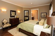 Warm Earth Tone Master Suite Design Ideas, Pictures, Remodel, and Decor.  I like the sage and cream cover.  The sets the stage.