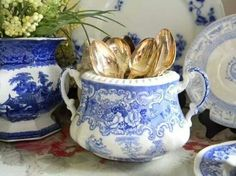 This is how I will display my vintage silverware (using a china tea pot).