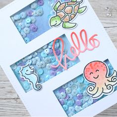 i created a three panel shaker card with a rectangle die on a A2 card. I used my distress oxides to create a fun blue bkgnd inside the shaker panels.I added some critters from Lawn Fawn to swim in my shaker sea and then added a SSS hello die to my card. I added some red ink to the top of the pink die cut, to mimic the cute octopus.