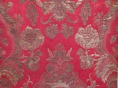 A panel of exquisite 17th century Italian red silk brocade with silver gilt wefts.