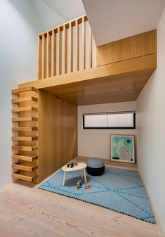 Glebe House by Nobbs Radford Architects -  bedroom tucked away on one side, opens out to a rooftop balcony