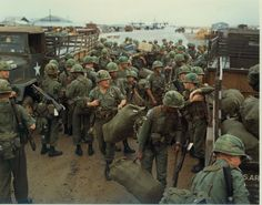 Soldiers from the 505th or 508th Airborne Infantry Regiment after arriving in-country. Notably, they wear third pattern sateen uniforms and jump boots. They also appear to have taken off their M1951 or M1965 field jackets and rolled them under their butt packs. This is evident by the button hole on the collar of one of the jackets that is tucked into the butt pack of the man on the left. The soldiers also wear full color insignia with the exception of subdued name tapes.