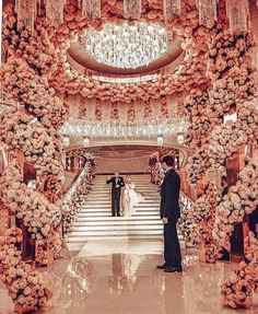 This breathtaking pink wedding decor is to die for! All those pink roses the incredible central chandelier and the total concept make our hearts beat faster And what would be the colour of your wedding decor? Wedding Ceremony Ideas, Wedding Hall Decorations, Wedding Themes, Wedding Venues, Decor Wedding, Reception Ideas, Destination Wedding, Glamorous Wedding, Elegant Wedding
