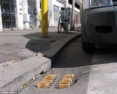 Artist Mark Jenkins has swamped the streets of Rome with his quirky art installations including these slices of toast popping out of a drain, giving pedestrians foor for thought as they do their daily commute. via dailymail.co.uk