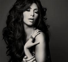 Kim Kardashian makeup and big hair