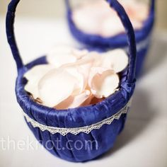 The flower girls carried petite blue baskets of ivory rose petals down the aisle.
