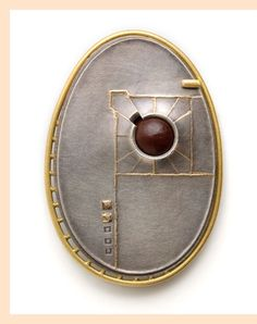 Shift, by Cappy Counard. 18K gold, sterling silver and seed.