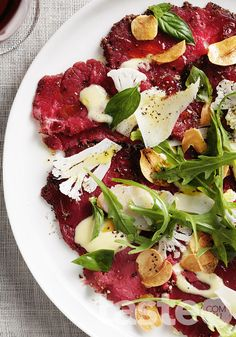 This recipe for beef carpaccio is great served on a platter as a shared starter for your next dinner party. (Recipe by Marion Grasby; Photography by Ben Dearnley)