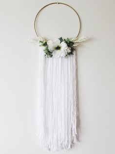 POSEY floral halo wall hanging - handmade with love! ❤ Would be beautiful in the home or at a wedding event!  FEATURES: Gold metal hoop, white floral and soft greens. Just so pretty and femme. SIZE: Approximately 33 inches from nail to bottom and hoop is 10 inches wide.  COLORS: White, soft green, metallic gold.  FREE U.S. SHIPPING!  Check out Loom Ghost on Instagram: @loom.ghost  To see other pieces I have made, please visit this link: http://www.eevieandthebees.com/p/sho...