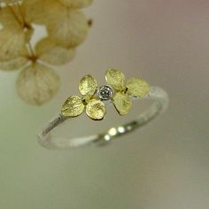 Tiny Hydrangea Ring Diamond Engagement Ring, conflict free.  This reminds me of your wedding band!