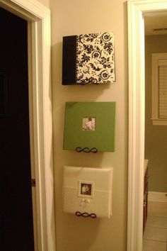 PHOTO ALBUMS DISPLAYED ON PLATE HANGERS! Such a great idea!