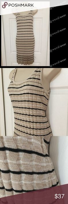 Ann Taylor LOFT striped sweater dress Brand new, never worn and still has purchase tag and RFID tag.  Beige, brown, white and black striped 100% rayon bodycon dress with slim, slinky fit.  Tank-top style top makes this a versatile dress that can be worn day or night! Ann Taylor LOFT Dresses Mini