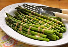 Roasted asparagus with a Sriracha drizzle, on The Perfect Pantry.