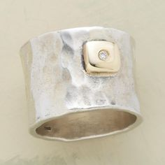 """DIAMOND DEWDROP BAND--A tiny diamond winks from the bezel of this 14kt gold diamond dewdrop band ring, on a broad swath of hand-hammered sterling silver. Exclusive. Whole sizes 5 to 9. Approx. 5/8""""W."""