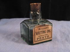 This is for a nice antique green glass inkwell with its original makers label still attached. It is advertising the makers Moncrieff's Writing Ink, Perth and the bottle is faceted on the shoulder. It is in excellent condition with the original cork and it has no cracks in the glass just a roughness to the rim and wear to the corners of the label.   eBay!