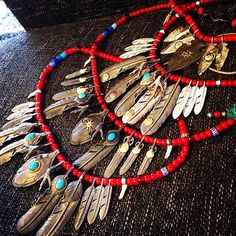 #goros#feathers#red#beads
