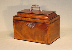 A mid 18th Century Chippendale period figured mahogany Tea Caddy, ebony beaded  mahogany cross-banded throughout, having concave shaped lid retaining original brass carrying handle. Circa: 1760