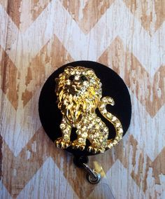 Gold lion retractable badge reel on Etsy, $12.00