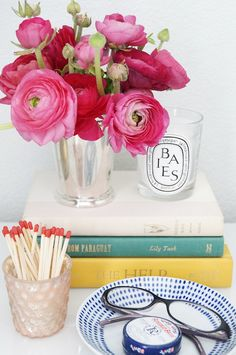 Find a pretty bowl for glasses, etc. on nightstand. Stack books to vary height of objects.  Be sure your candles are free and clear to burn safely.