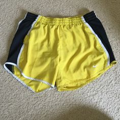 Yellow Nike Running Shorts BOGO Everything in my closet is BOGO free! Slightly used, but still in great condition! Nike Shorts