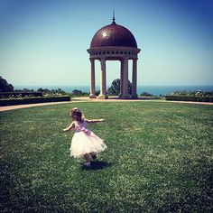 """Thank you for sharing your favorite #pelicanhill #memory with us, Cheryl! """"My husband and daughter treated my mother and I to a wonderful mother's day brunch in the ballroom at Pelican Hill Resort. It was a fantastic brunch with face painting and amazing food. After Brunch we walked the grounds and my daughter decided she wanted to fly like a bird. She looks like an angel to me, she is my little angel."""""""