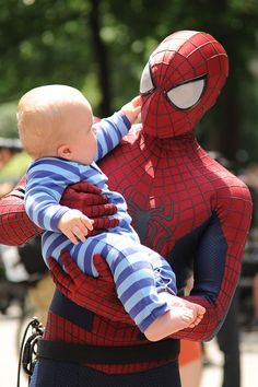 Andrew Garfield entertains a young fan on the set of The Amazing Spider Man 2 in New York.
