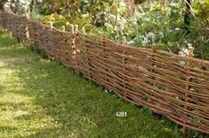 Garden wall or border... maybe for infront of the fence and behind the flowers to hide the chain link? Willow and dogwood... could be cool!