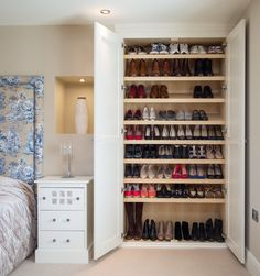 Transitional Closet by Acastrian Bespoke Fitted Furniture - Transform a cupboard. I love this idea for being straightforward and doing the job so reliably well. A large linen closet or wardrobe has been overhauled into a huge shoe storage cabinet, thanks to rows of slanted shelves, allowing enough space underneath for taller boots.
