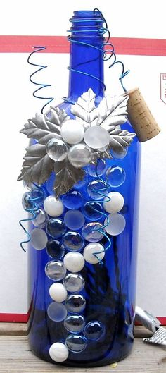 Decorative Embellished Blue, Silver, and White Wine Bottle Light.