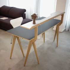 The walking desk designed by Michael Hilgers for furniture design system comapny Sudbrock GmbH Möbelhandwerk is an integrated shelving which can turn into a functional table as a workplace. #desk #wooden #frame #berlinerbock #table #shelf #workspace #furniture_design #furnituretrends #michaelhilgers