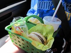 Tired of fast food ruining your car floors?   Shower caddies are a simple solution to keeping meals in place during a bumpy ride, which is especially helpful with kids.