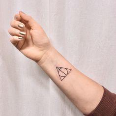 Deathly hollow symbol tattoo