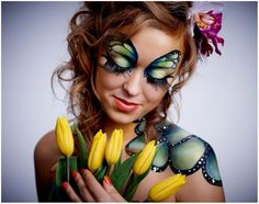 Creative and colorful butterfly inspired fantasy make-up with crystal accents.