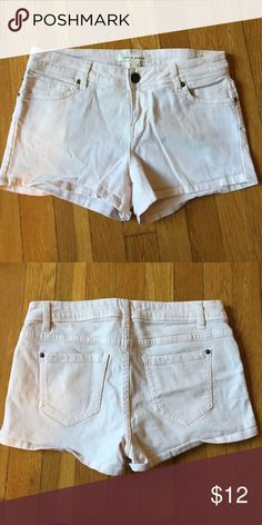 Forever 21 brand pale pink shorts size 26 Super stretchy denim like jean shorts in very pale pink. Super comfy. Button close. Size 26 but they fit more like a size 25. 99% cotton, 1% spandex (but trust me, they are stretchy). Forever 21 Shorts