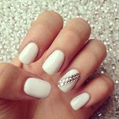 White fingernails w/clear gems on finger next to pinky finger!