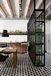 Reclaimed wood kitchen with industrial style partition.