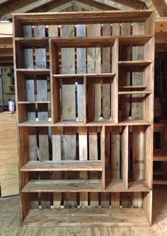 Bookshelf made out of old pallets -- great storage idea is rustic is your look!