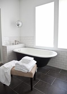 white subway wainscoting in bath, black clawfoot black bathroom by the style files, via Flickr