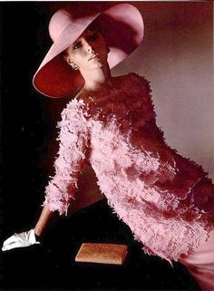 Yves Saint Laurent,1964. I had a red straw hat like this in the 60's. Loved that hat. Still sorry I got rid of it. What a great vintage piece it would be now.