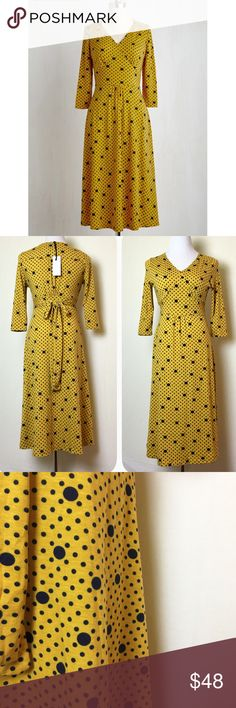 Mustard and navy dress. Frockshop for Modcloth. Comfy and cute jersey midi dress. Mustard with navy polka dots. 3/4 sleeves, v neck, fitted at waist with tie back. New with tags. ModCloth Dresses Midi