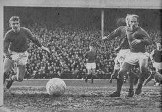 26th December 1968. Panic in the Manchester United defence as Alex Stepney and Bobby Charlton watch anxiously as the ball just misses the post against Arsenal, at Highbury.
