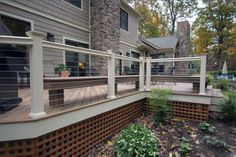 modern deck idea with stainless steel cable railing and white concrete rail posts cedar lattice house skirting in square shape cedar deck floors of Raised House Skirting: Smart Solution for Hiding Pie (Diy House Exterior) House Skirting, Deck Skirting, Cool Deck, Diy Deck, Lattice Deck, Square Lattice, Raised House, Cedar Deck, Modern Deck