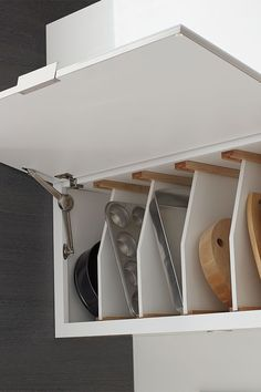 Our Tray Divider for Wall Top Hinge cabinets provides vertical above counter access to bakeware, cutting boards and other tall, thin items. Tall Kitchen Cabinets, Bathroom Wall Cabinets, Kitchen Tops, Diy Cabinets, Kitchen Ideas, Crazy Kitchen, Kitchen Shelves, Kitchen Reno, Small Cottage Kitchen
