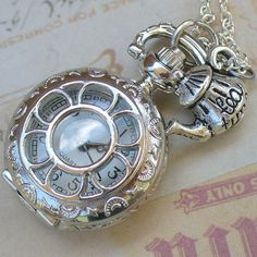 """Pocket watch and """"tea time"""" teapot charm necklace."""